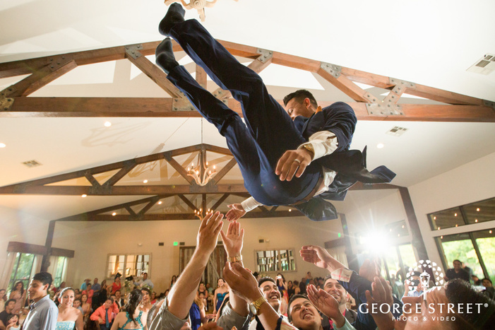 pecan springs ranch austin wedding reception groom candid dance floor