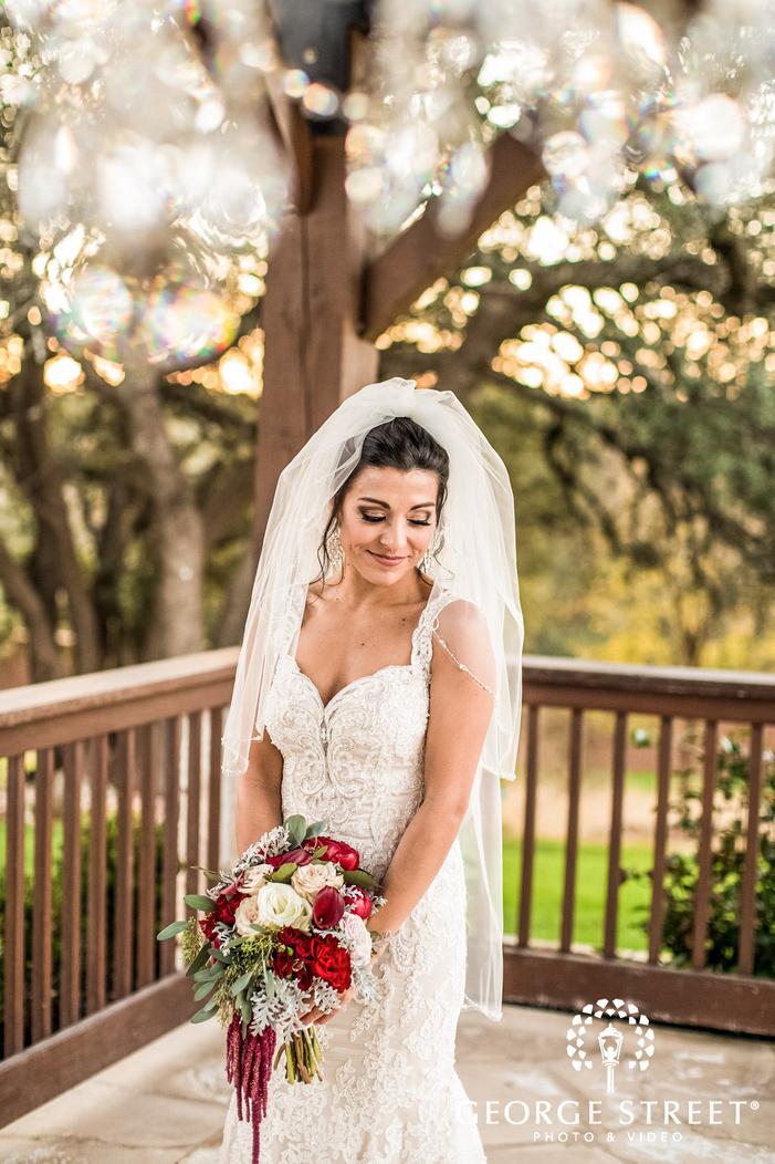 beautiful bride on terrace gabriel springs austin wedding photos