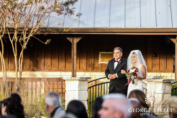 blissful ceremony entrance of bride and father gabriel springs austin wedding photos