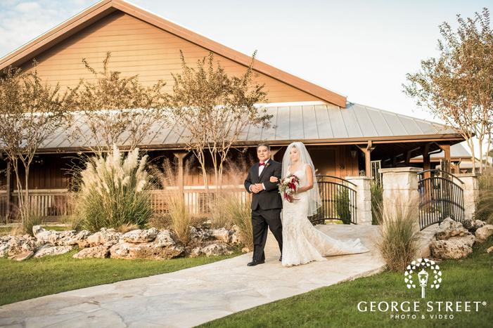 bride and father walk down the aisle gabriel springs austin wedding photos