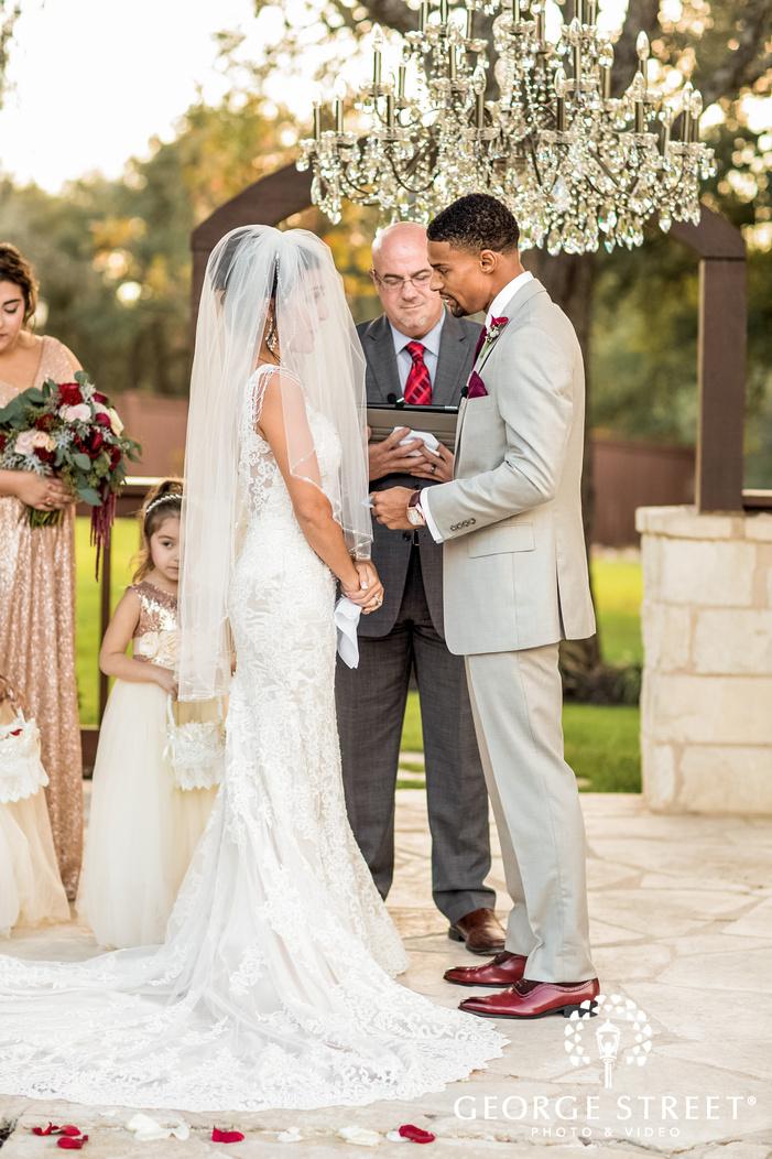 bride and groom exchange vows on altar gabriel springs austin wedding photos