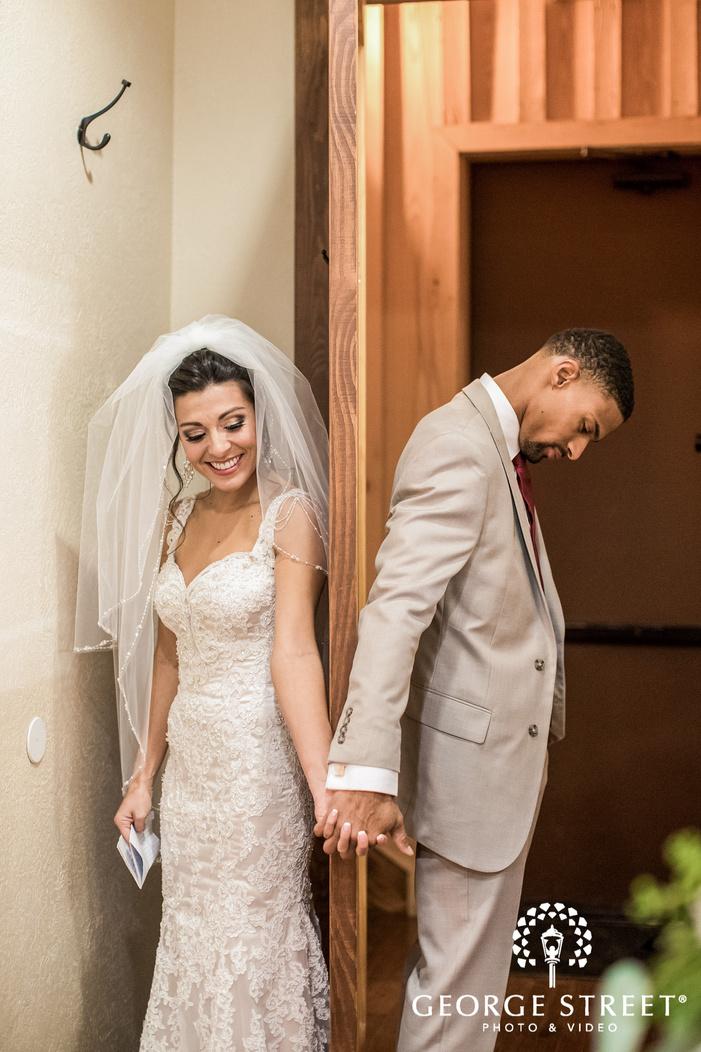 gabriel springs lovely couple first look door austin wedding photos