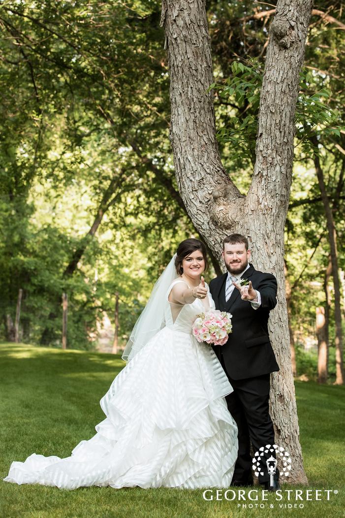 joyful bride and groom in green forest wedding photography