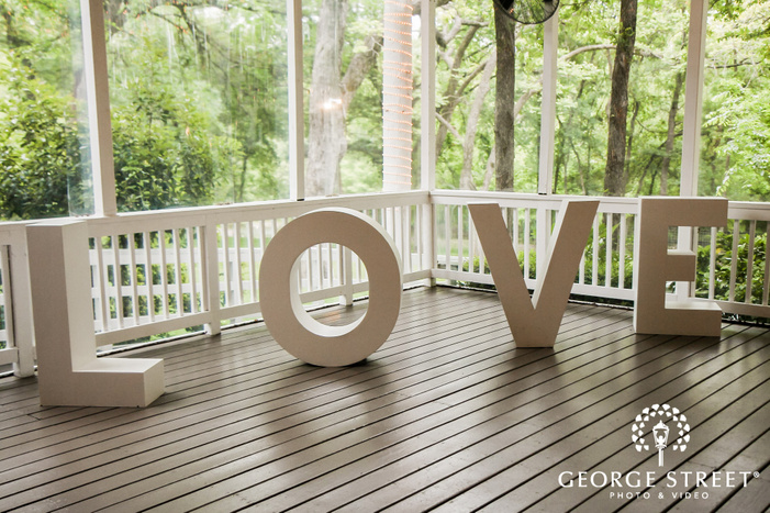 lovely white sculpture in patio wedding photo