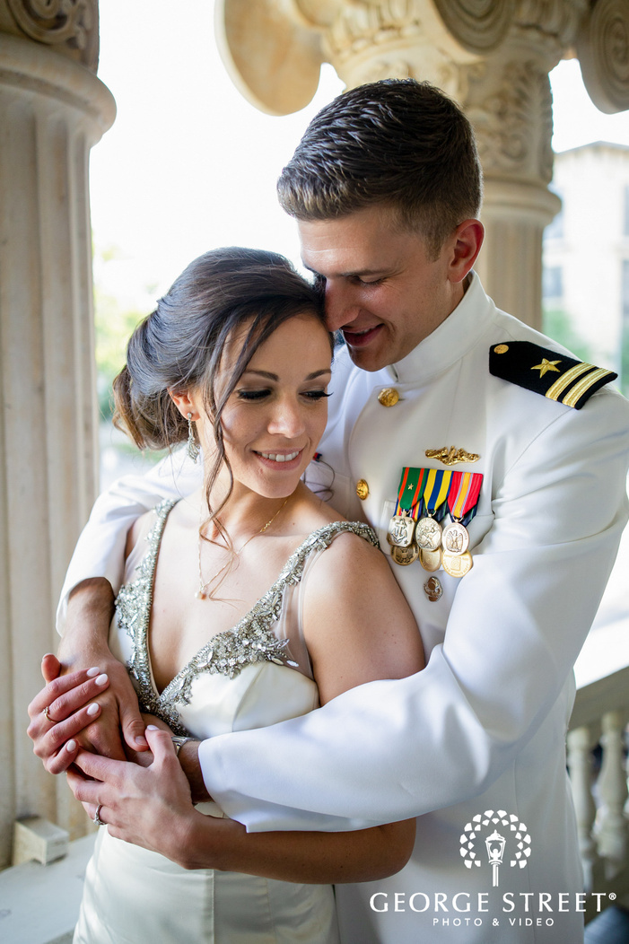 adorable bride and groom near pillars wedding photography