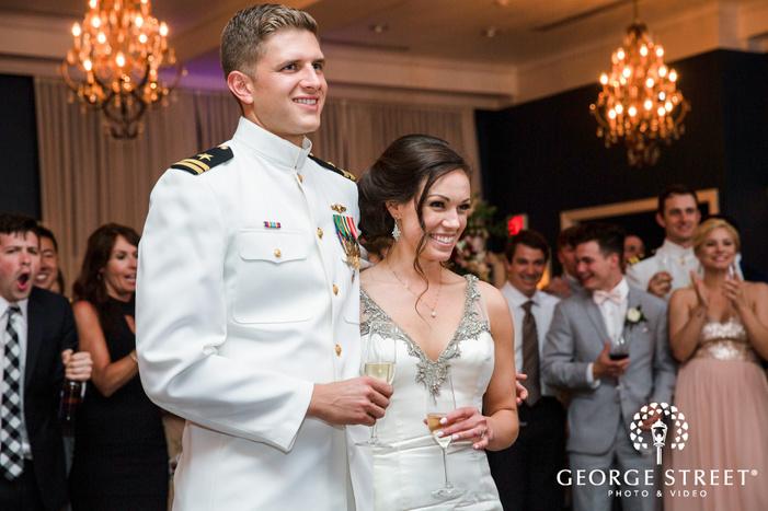 cheerful bride and groom during reception toast wedding photos