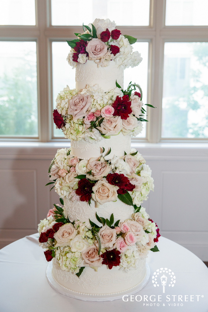 elegant four tier white flower wedding cake wedding photo