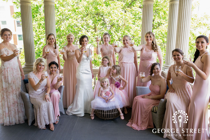 gorgeous bride and bridesmaids on balcony wedding photography