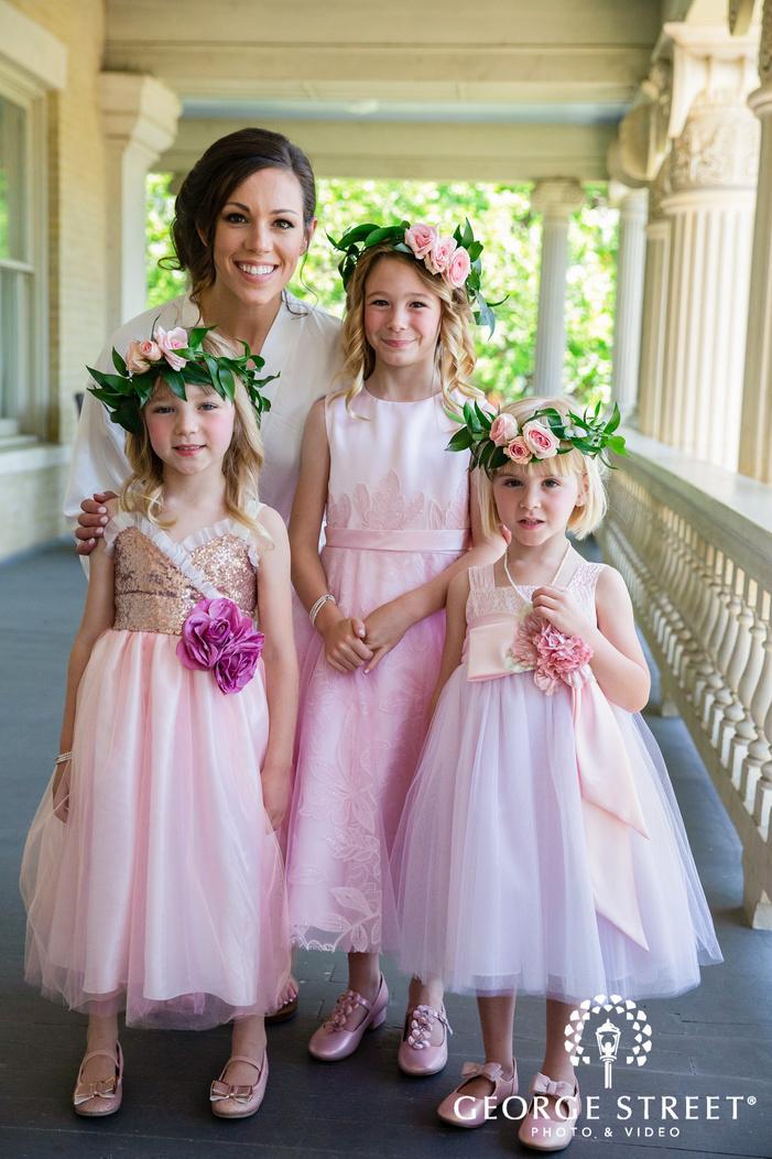 pretty bride and kids in corridor wedding photography