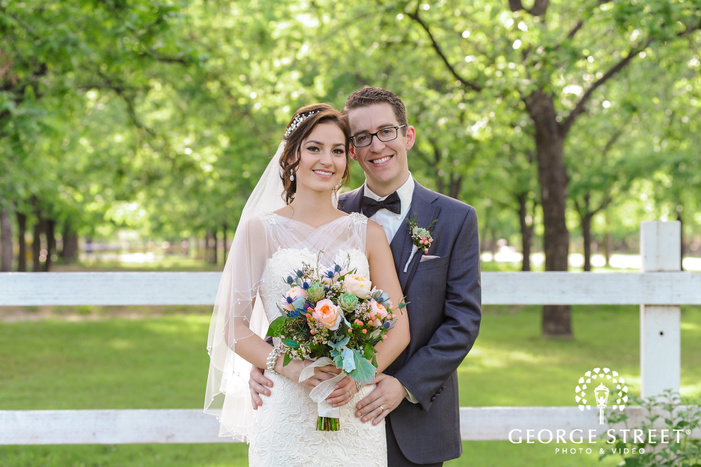 charming bride and groom in green field at venue at the grove in phoenix