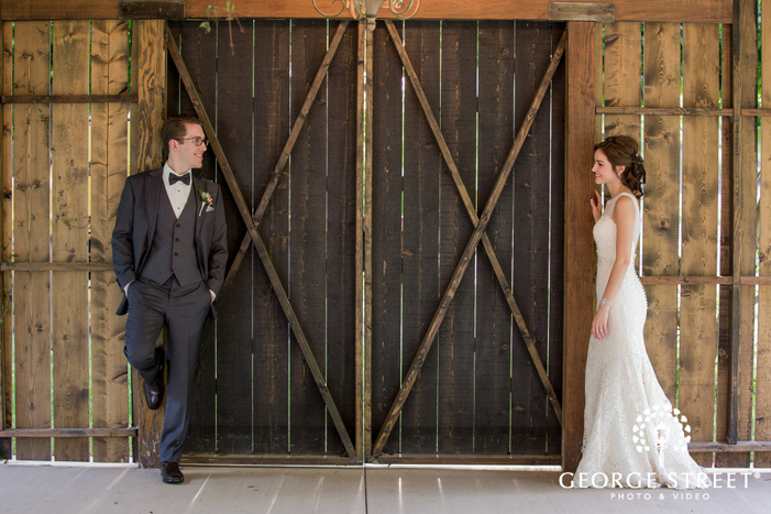 loving bride and groom in barn at venue at the grove in phoenix