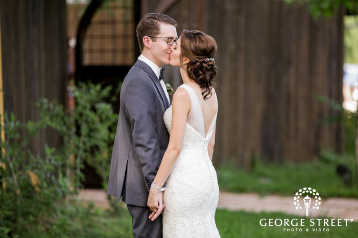 romantic bride and groom near shed wedding photography