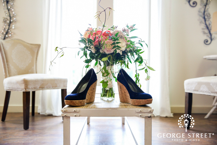 beautiful bridal shoes and bouquet wedding photo