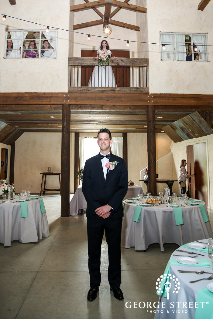handsome groom in reception hall wedding photography