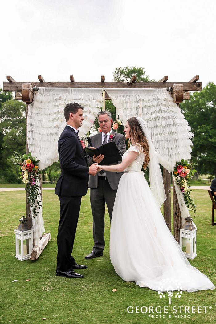 happy bride and groom ring exchange wedding photos