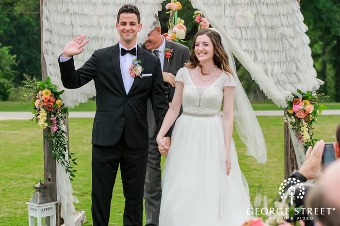 joyful bride and groom ceremony exit wedding photos