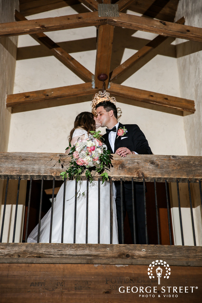 romantic bride and groom at indoor balcony wedding photography