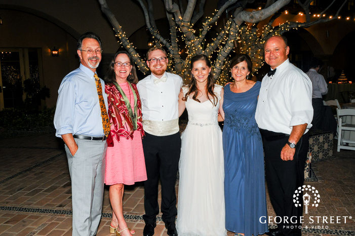 attractive bride and groom with guests at reception