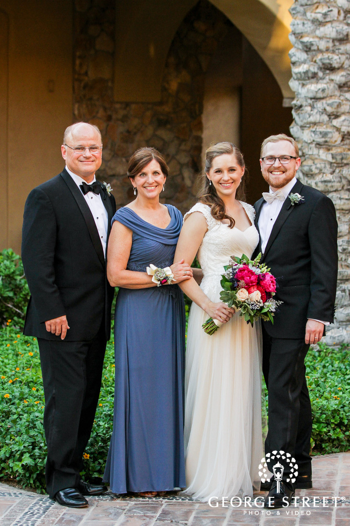 happy bride and groom with parents