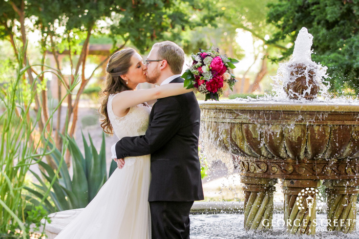lovable bride and groom infront of fountain