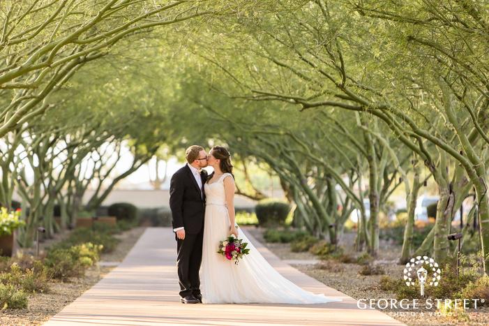 romantic bride and groom on walkway