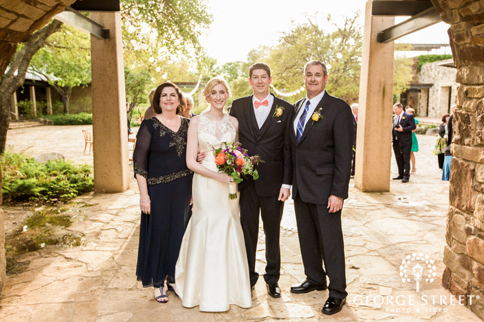 attractive bride and groom with parents