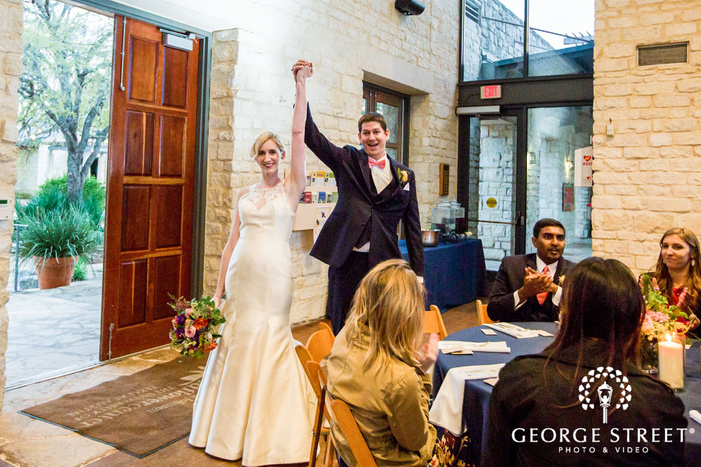 excited bride and groom at reception entrance
