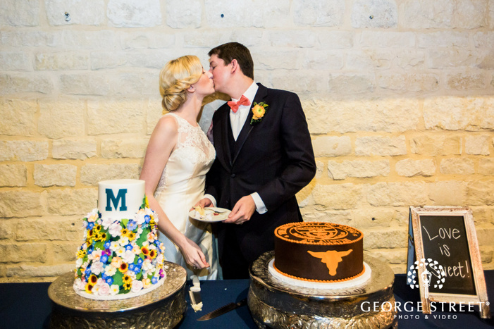 lovely bride and groom at cake cutting ceremony