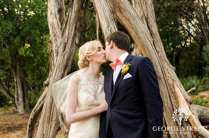 loving bride and groom in yard
