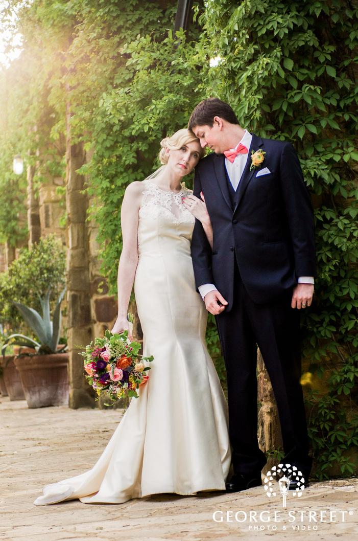 pretty bride and groom on walkway wedding photgraphy