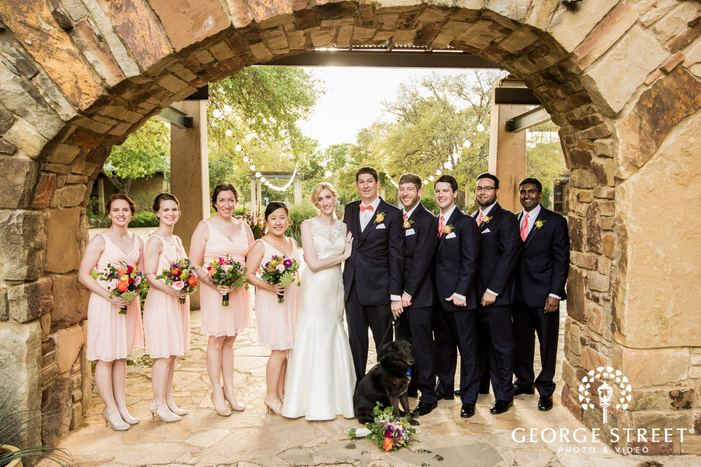 sweet couple with bridesmaids and groomsmen at lady bird johnson wildflower center in austin