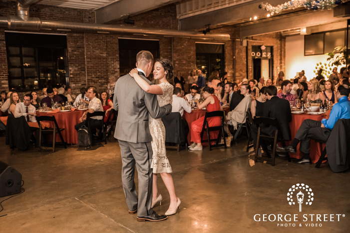 adorable bride and groom first dance in reception party at third degree glass factory in st  louis wedding photography