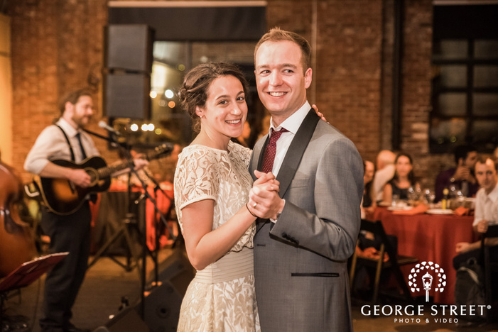 blissful bride and groom enjoying dance in reception wedding photos