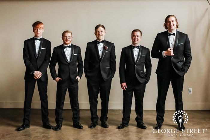 handsoem groom and groomsmen in reception hall wedding photography