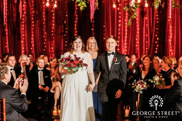 happy bride and groom ceremony exit wedding photography