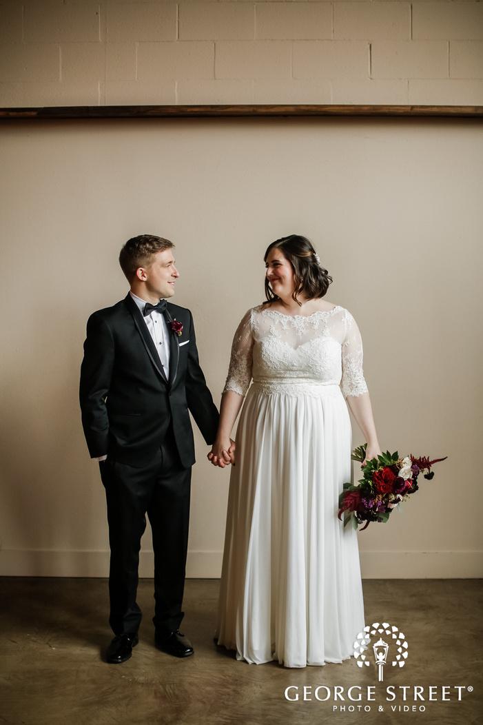 happy bride and groom in room wedding photo