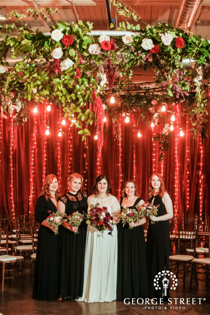 pretty bride and bridemaids in reception hall at the foundry in seattle