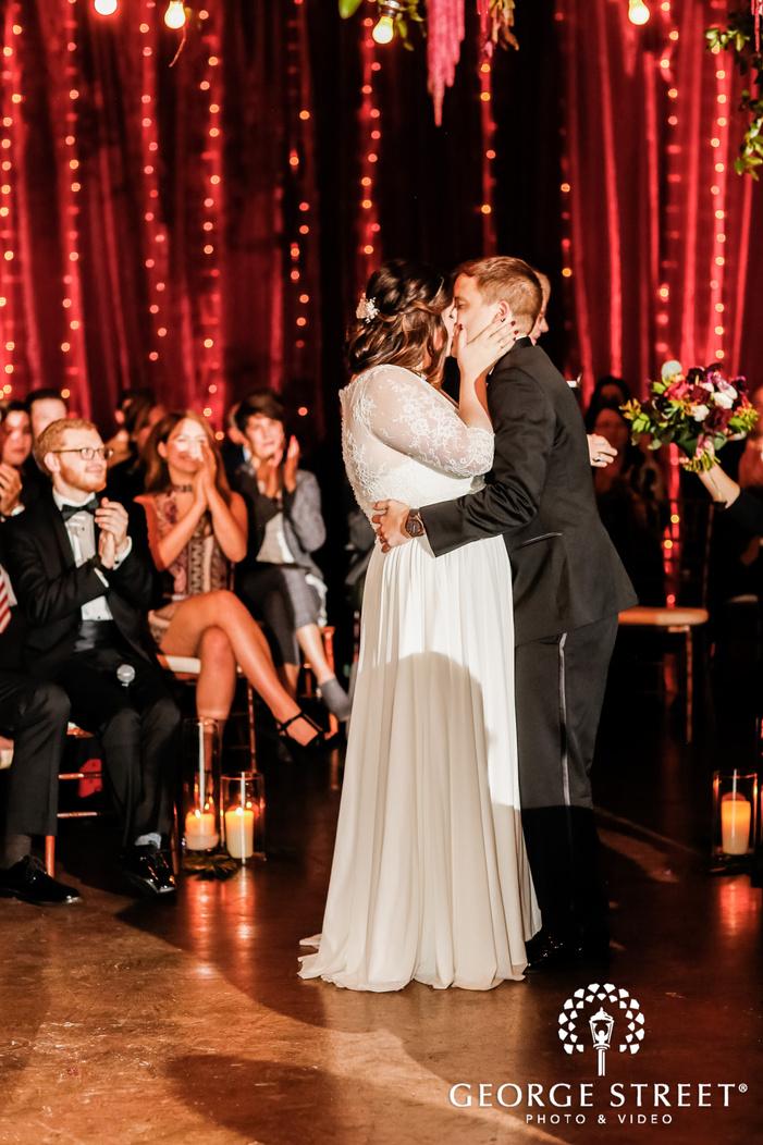 romantic couple first kiss wedding photo