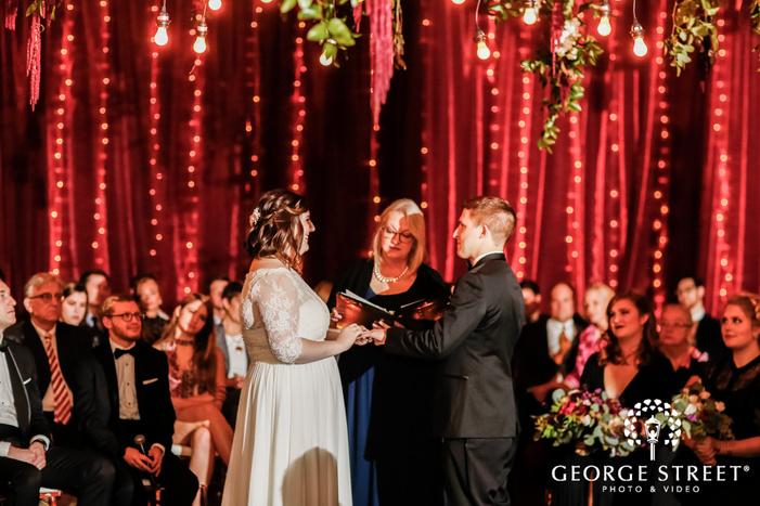 sweet birde and groom ring exchange ceremony wedding photo