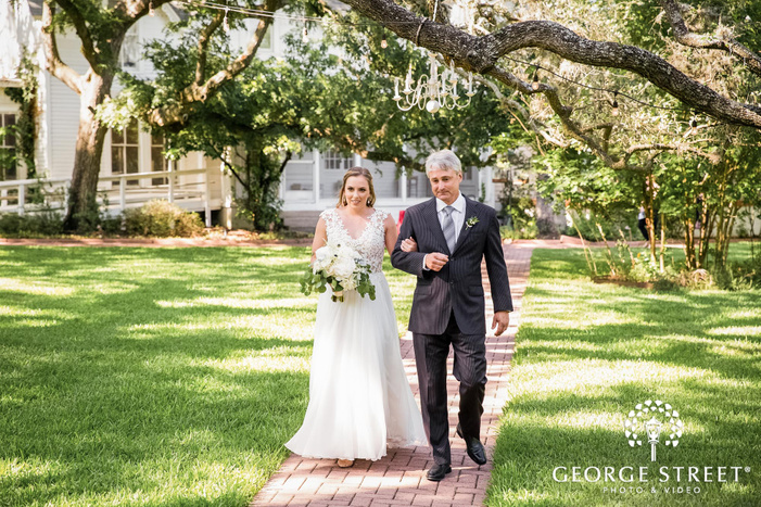 beautiful bride and father at wedding ceremony entrance