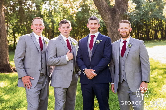 handsome groom with friends wedding photos