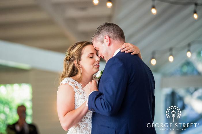 romantic bride and groom dance in austin