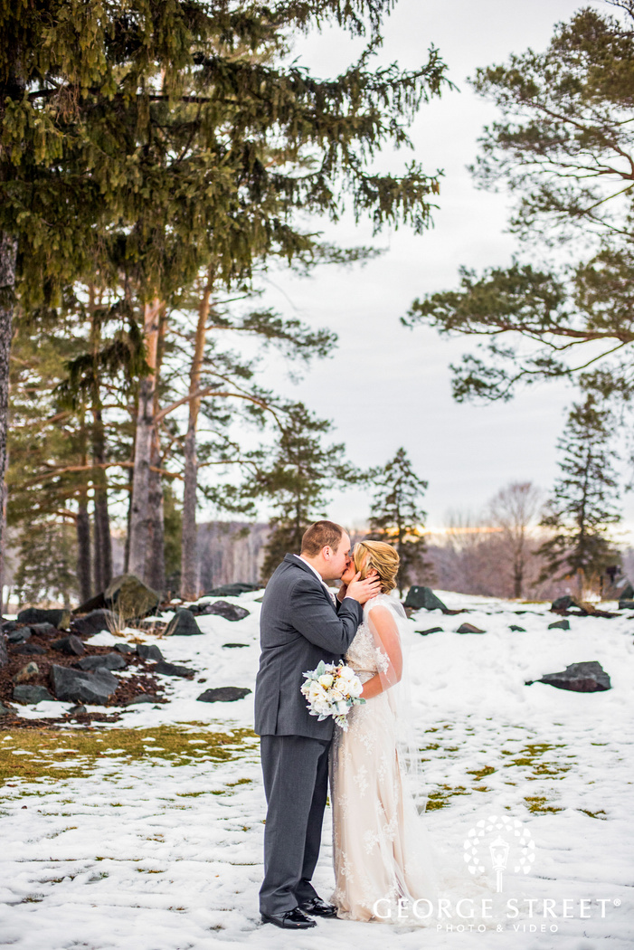 candid bride and groom outdoor winter portrait