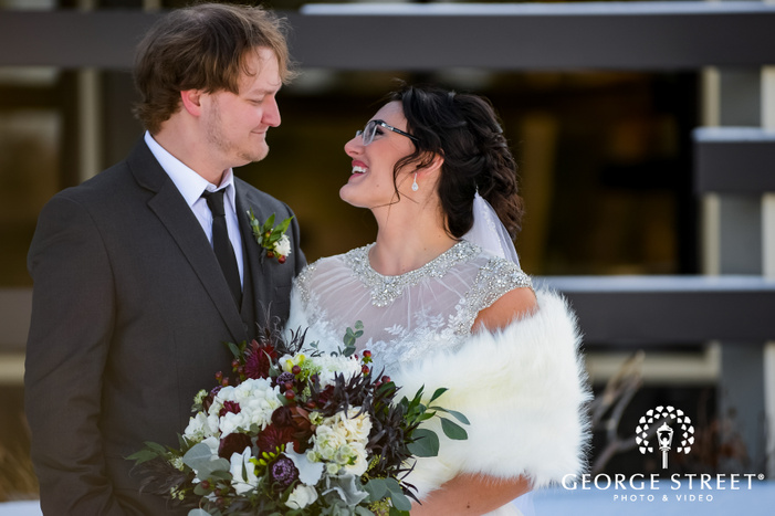 close up bokeh shot of newly married bride and groom smiling and looking at each other wedding photography