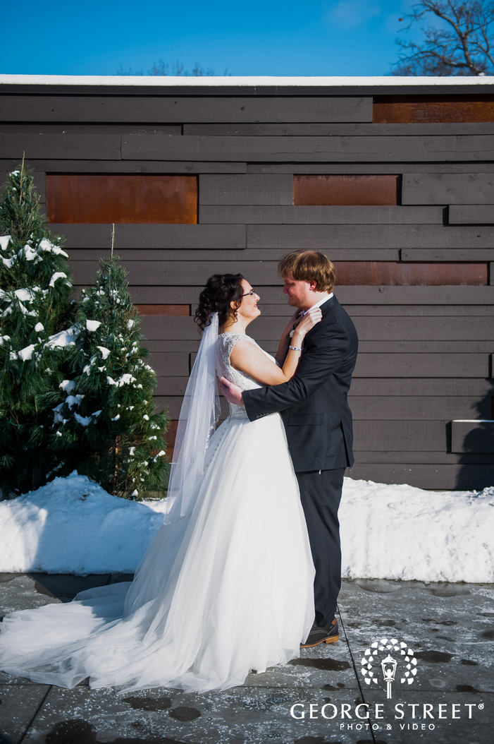 portrait shot  of groom and bride romantically looking at each other wedding winter photography