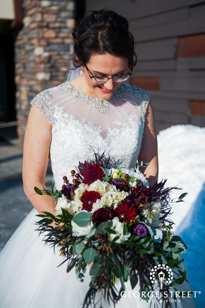 portrait shot of bride posing solo holding a bouquet outside the wedding venue