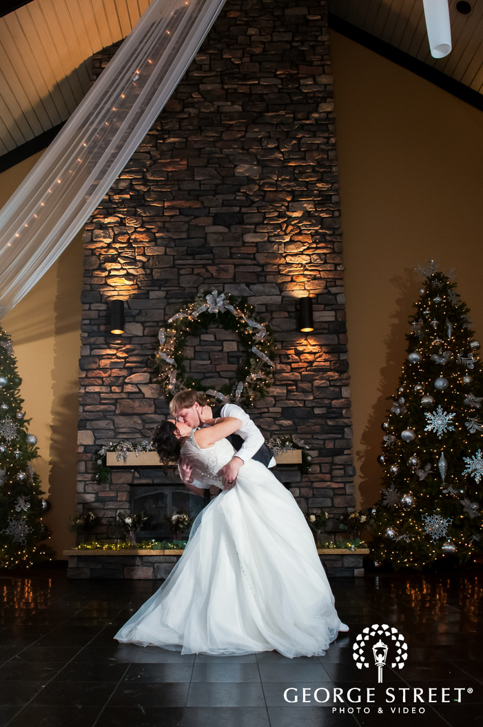 portrait shot of newly wedded couple kissing during their first dance wedding reception photography