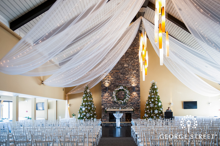 wide angle shot of the empty ailse lined up with white chairs with the altar in the back wedding ceremoy photography