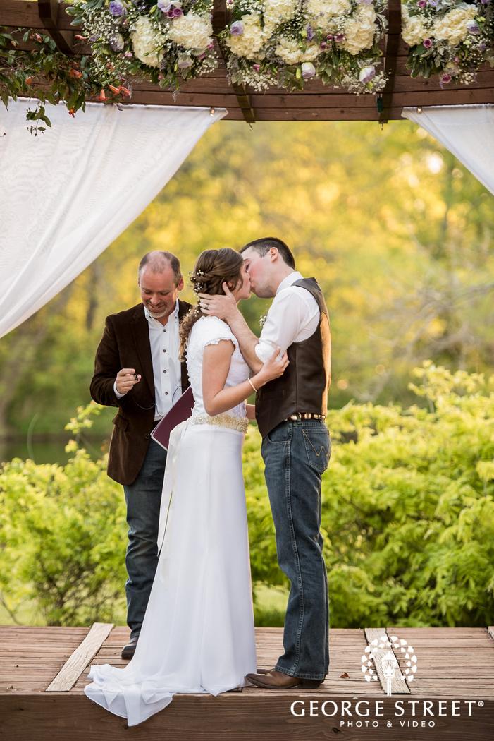 bride and groom first kiss cross creek ranch dallas fort worth wedding photos