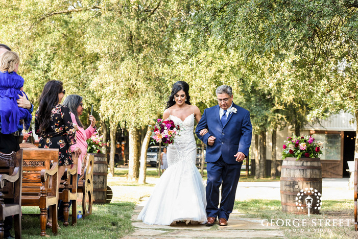 adorable bride and father walking down the aisle